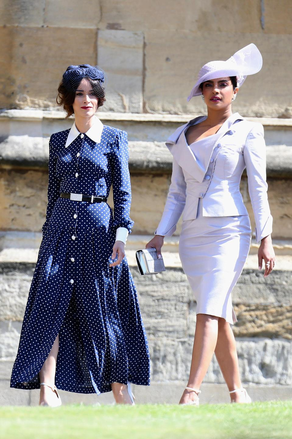 Actress Abigail Spencer, pictured with fellow guest Priyanka Chopra, first wore the Alessandra Rich dress to the royal wedding. (Photo: Chris Jackson/Getty Images)