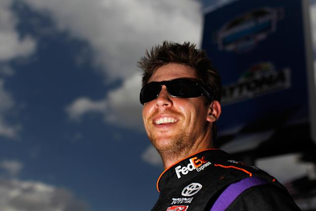 DAYTONA BEACH, FL - FEBRUARY 19: Denny Hamlin, driver of the #11 FedEx Express Toyota, looks on during qualifying for the NASCAR Sprint Cup Series Daytona 500 at Daytona International Speedway on February 19, 2012 in Daytona Beach, Florida. (Photo by Tom Pennington/Getty Images for NASCAR)