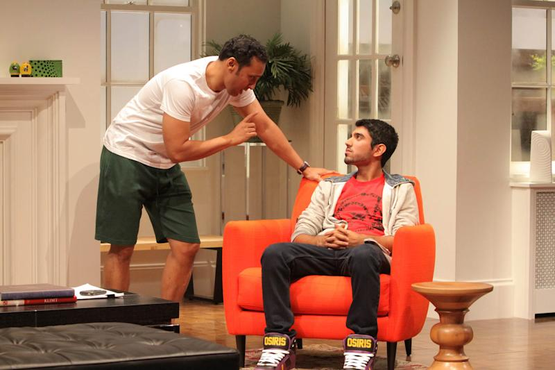 """This theater image released by Philip Rinaldi Publicity shows Aasif Mandvi, left, and Omar Maskati in a scene from Ayad Akhtar's play, """"Disgraced"""" in New York. Akhtar was awarded the 2013 Pulitzer Prize for Drama for his work """"Disgraced"""", on Monday, April 15, 2013. (AP Photo/Philip Rinaldi Publicity, Erin Baiano)"""