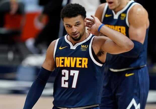 Denver Nuggets guard Jamal Murray was among the Canadians to commit to the Olympic qualifying tournament in November 2019, but his participation hinges on the success of his NBA team. (David Zalubowski/The Associated Press - image credit)