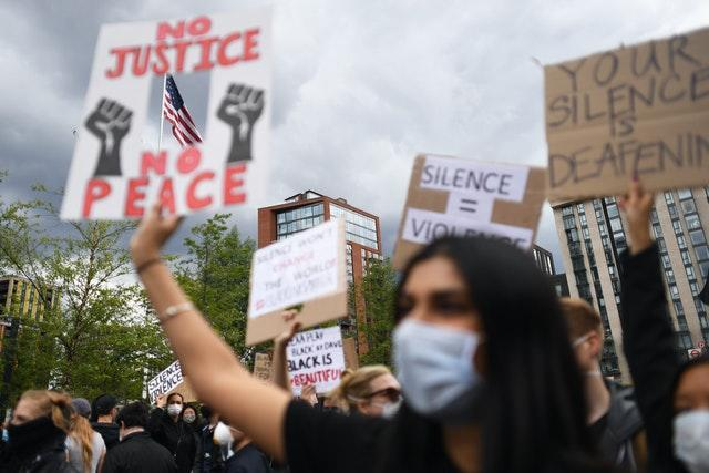 People take part in a Black Lives Matter protest rally at the US Embassy, London