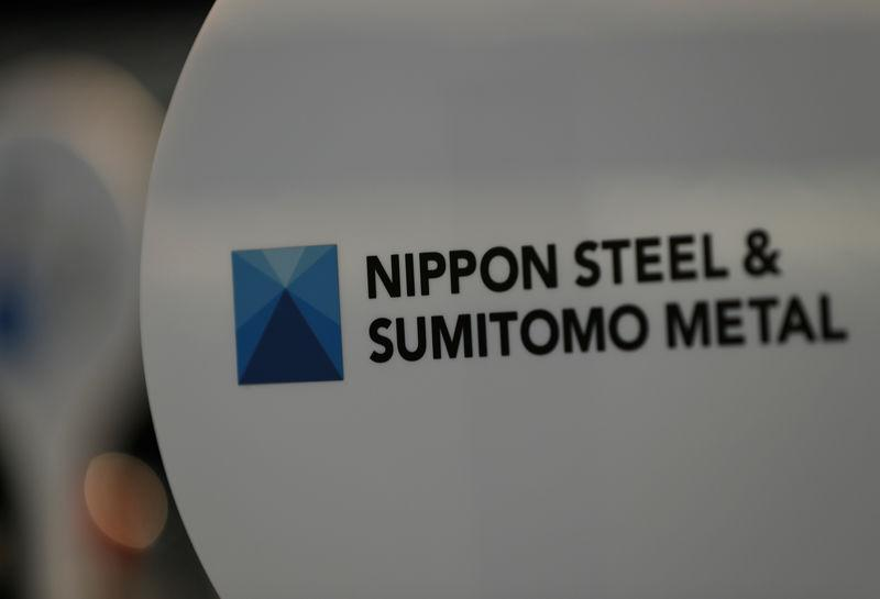 The logo of Nippon Steel & Sumitomo Metal Corp.'s Kimitsu steel plant is pictured at its exhibition hall in Kimitsu