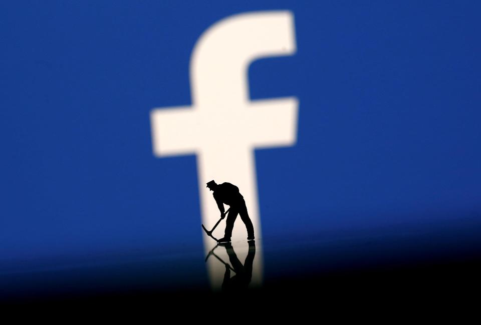 FILE PHOTO: A figurine is seen in front of the Facebook logo in this illustration taken, March 20, 2018. REUTERS/Dado Ruvic/Illustration/File Photo