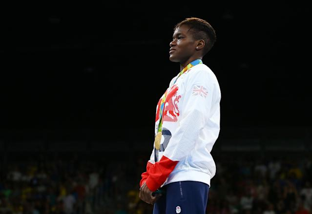 2016 Rio Olympics - Boxing - Victory Ceremony - Women's Fly (51kg) Victory Ceremony - Riocentro - Pavilion 6 - Rio de Janeiro, Brazil - 20/08/2016. Gold medallist Nicola Adams (GBR) of Britain stands at attention. REUTERS/Peter Cziborra FOR EDITORIAL USE ONLY. NOT FOR SALE FOR MARKETING OR ADVERTISING CAMPAIGNS.