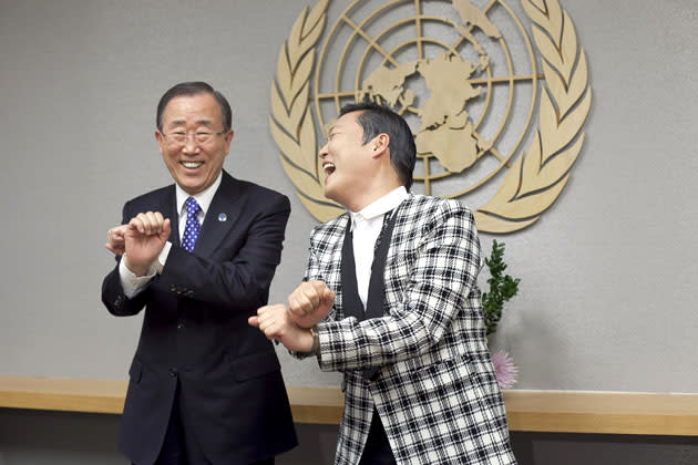 South Korean singer Psy (R), whose real name is Park Jae-sang, visits UN Secretary General Ban Ki-moon at the United Nations on October 23, 2012 in New York City.  (Photo by Allison Joyce/Getty Images)