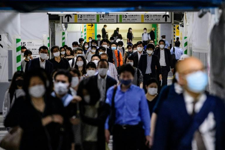 There were fears packed Tokyo could become a hotbed for the virus (AFP Photo/Philip FONG)