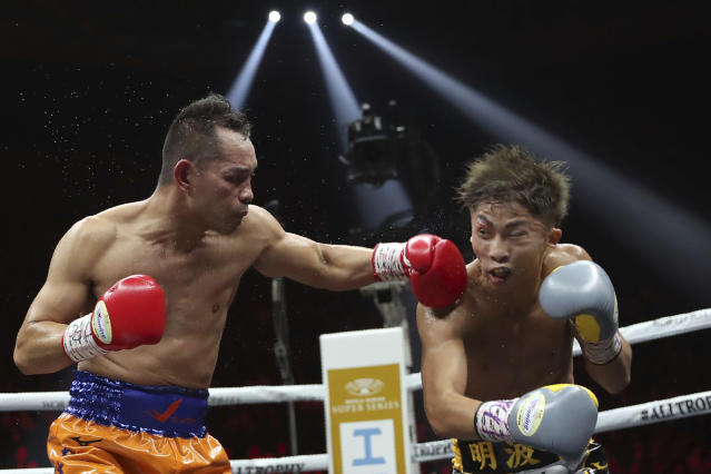 Philippines' Nonito Donaire, left, sends a left to Japan's Naoya Inoue in the fourth round of their World Boxing Super Series bantamweight final match in Saitama, Japan, Thursday, Nov. 7, 2019. Inoue beat Donaire with a unanimous decision to win the championship. (AP Photo/Toru Takahashi)