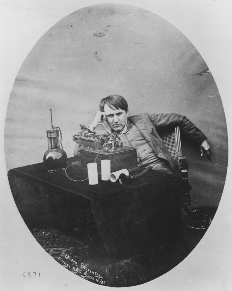 This 1888 photo provided by the Museum of Innovation and Science in Schenectady, N.Y., shows Thomas Edison listening to a wax cylinder phonograph. Researchers have digitized what experts say is the oldest recording of a playable American voice and history's first-ever recorded musical performance, along with the first recorded blooper. Recorded on a sheet of tinfoil on a phonograph invented by Thomas Edison, the recording was made in St. Louis in 1878. It contains a short coronet solo of an unidentified song, followed by the voices of a man reciting popular nursery rhymes. (AP Photo/Mike Groll)