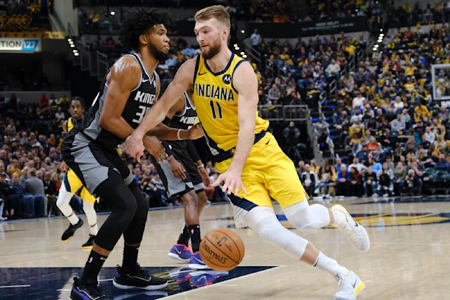 Indiana Pacers forward Domantas Sabonis (11) goes around Sacramento Kings forward Marvin Bagley III (35) during the second half of an NBA basketball game in Indianapolis, Friday, Dec. 20, 2019. The Pacers won 119-105. (AP Photo/AJ Mast)