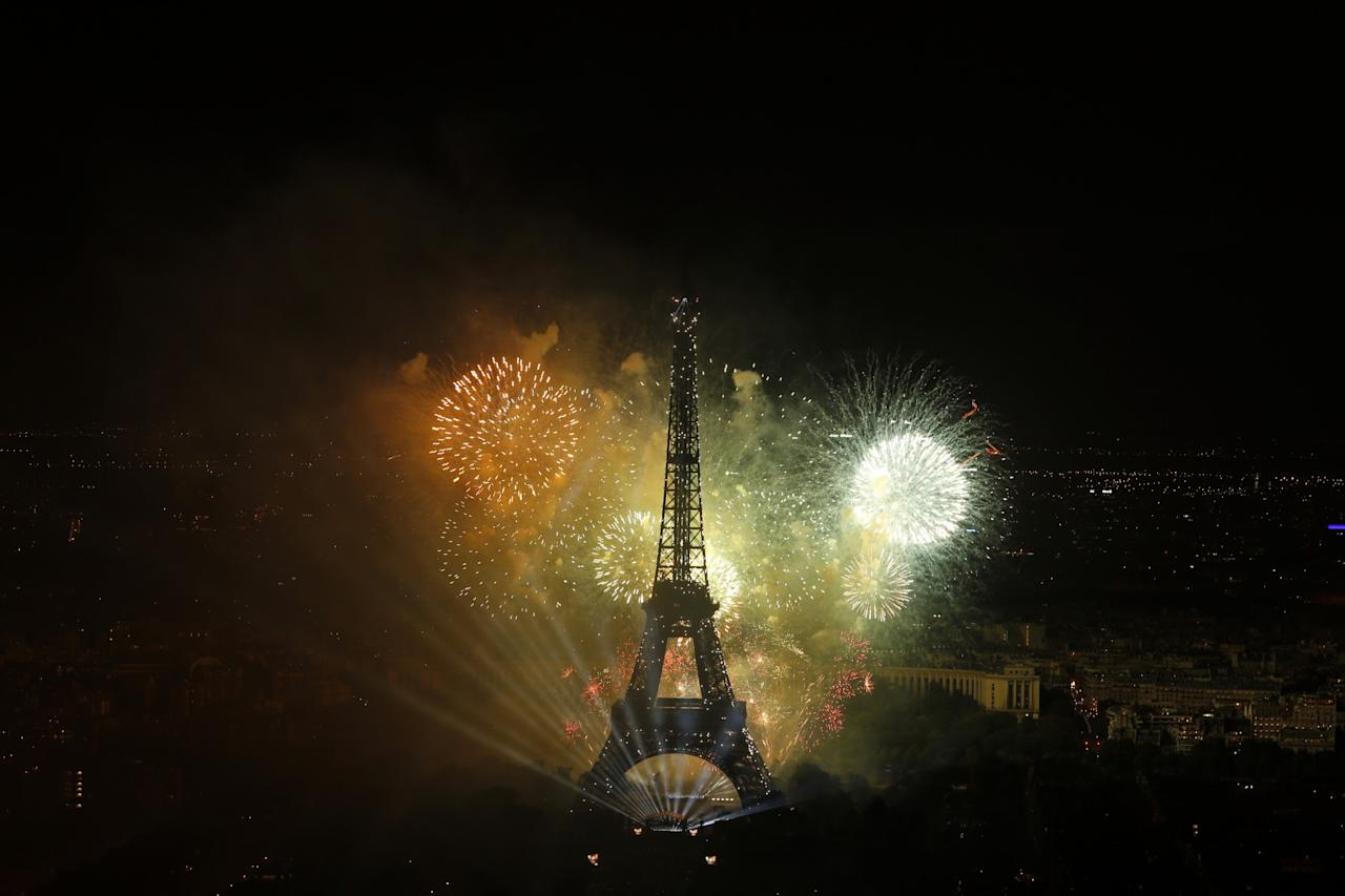 <p>A view of the fireworks display by the Eiffel tower on Bastille Day, in Paris, France. (AP Photo/Matthieu Alexandre) </p>