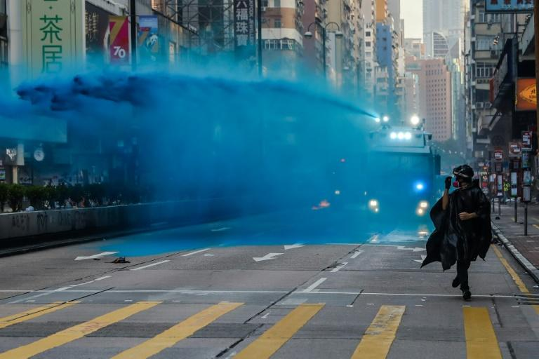 Hong Kong police have used blue dye as a way to identify protesters during confrontations (AFP Photo/DALE DE LA REY)