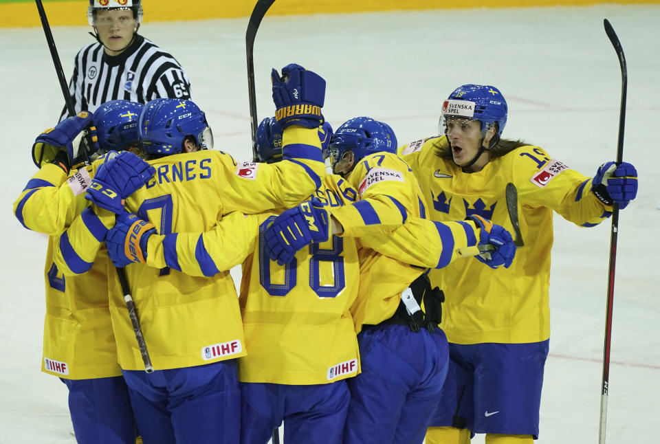 Players of Sweden celebrate during the Ice Hockey World Championship group A match between the Sweden and Slovakia at the Olympic Sports Center in Riga, Latvia, Sunday, May 30, 2021. (AP Photo/Oksana Dzadan)