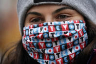 Zoe Wynn, a sophomore at Bates College, from Mill Valley, Calif., wears a mask to help prevent the spread of the coronavirus while attending a campaign event held by Democratic candidate for Senate, Sara Gideon, Friday, Oct. 30, 2020, in Lewiston, Maine. (AP Photo/Robert F. Bukaty)