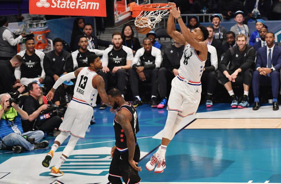 Giannis Antetokounmpo throws one down in the first half Sunday night. (AP)