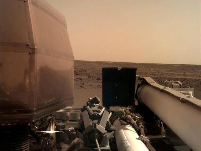 FILE PHOTO: The Instrument Deployment Camera's image of the Martian surface the day the spacecraft touched down on the Red Planet