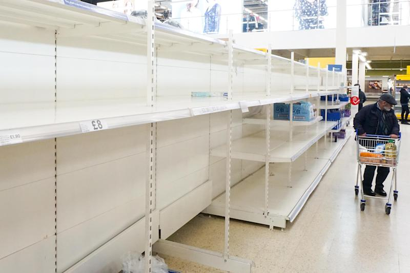 Empty shelves of Tesco supermarket as customers look for food in Sheffield , England , 22 March 2020. (Photo by Giannis Alexopoulos/NurPhoto via Getty Images)