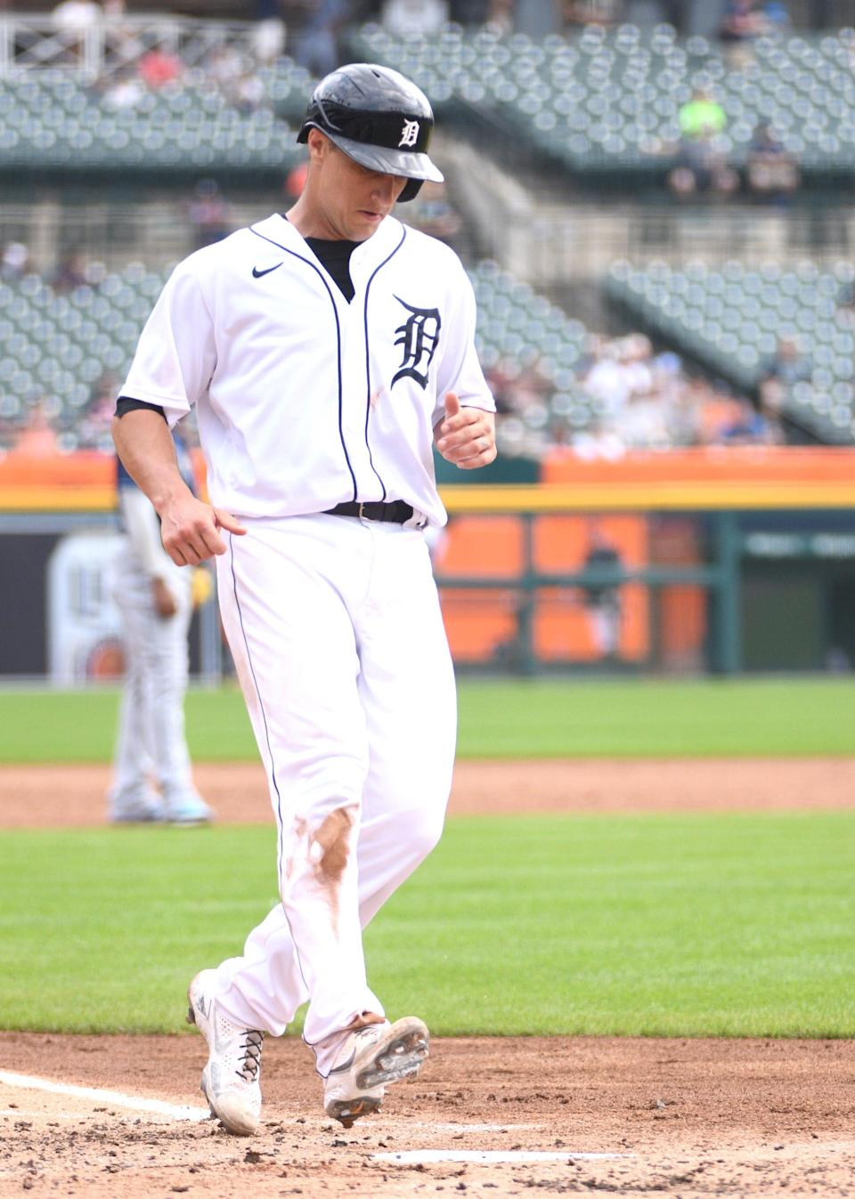 Detroit Tigers catcher Dustin Garneau scores during the third inning against the Tampa Bay Rays at Comerica Park, Sept. 12, 2021.