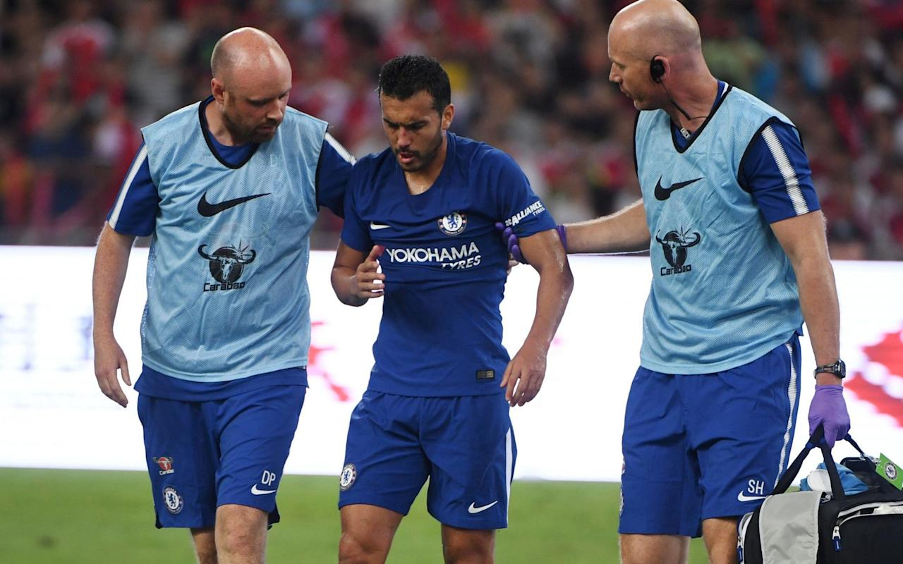 "Chelsea forward Pedro has suffered a fractured cheekbone and is a serious doubt for the Community Shield next month. Antonio Conte, the Chelsea manager, has revealed that Pedro sustained ""multiple fractures"" after his collision with Arsenal's David Ospina on Saturday evening. The Spain international will miss 10 days of training and will wear a mask when he returns, with Conte admitting the injury was far more serious than he first envisaged. Pedro clashed with Ospina midway through the first half of Chelsea's 3-0 win over Arsenal in Beijing and taken to hospital. He has not joined the rest of the squad in Singapore and is now rated doubtful for the Charity Shield against Arsenal on August 6. Pedro was hurt in this collision with David Ospina Credit: AP Conte said: ""The situation was more serious. I hoped it would be only concussion. He had multiple fractures but I think with a mask in 10 days he could come back to work with us."" Chelsea will continue their pre-season preparations when they face Bayern Munich in the International Champions Cup on Tuesday. Alvaro Morata, the club record £58million signing, is expected to play some part after flying in on Sunday. Antonio Rudiger, the defender signed from Roma earlier this month, will join up with the squad tomorrow. Premier League done deals: each club's confirmed summer transfers Conte said: ""It is my plan to give him the possibility to play a part in the game. For sure, not from the start as he arrived only yesterday, he started working very strong but for sure I want to give him the chance to play some part of the game. ""He is a young player who has a lot of experience in his career, he played for two big teams, Real Madrid and Juventus, and played different games in the Champions League and won the last Champions League. ""He is ready to have a good impact in the Premier League."" 15 Premier League youngsters who deserve a chance"