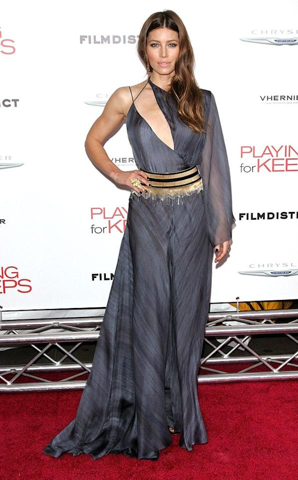 """Speaking of head-turning ensembles, take a look at the daring Versace design Jessica Biel donned at the Big Apple debut of """"Playing for Keeps."""" Are you fond of her fashion-forward frock, which featured a tie-dyed print, single sheer sleeve, and fringed belt? We happen to love it, along with her freshly highlighted locks, Lorraine Schwartz cocktail ring, and dark nail polish. Discuss! (12/5/2012)"""