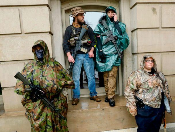 PHOTO: Armed demonstrators protest in Lansing, Mich., during a rally organized by Michigan United for Liberty on May 14, 2020, to protest the coronavirus pandemic stay-at-home orders. (Jeff Kowalsky/AFP via Getty Images)