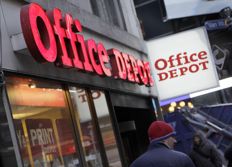 In this Dec. 20, 2010 photo, an Office Depot store, near New York's Times Square, is shown. Office supply retailer Office Depot Inc. said Tuesday, Feb. 22, 2011, that its fourth-quarter loss shrank by 25 percent. Not counting one-time charges, however, it beat Wall Street analysts' expectations. (AP Photo/Richard Drew)