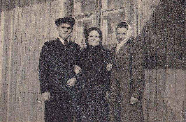 Their father Mikhail, grandmother and mother Katya. Picture: Julie Butler