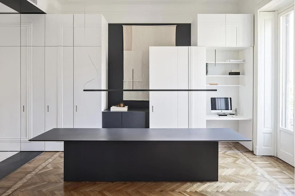 This elegant Milan loft renovation saw the inclusion of multiple cabinets to create new mini-stations for the apartment's occupant.