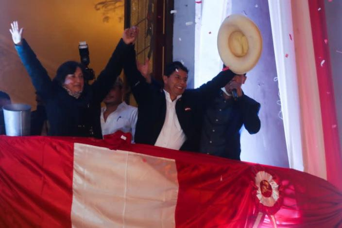 Leftist Pedro Castillo celebrates after Peru's electoral authority announced him as the winner of the presidential election, in Lima