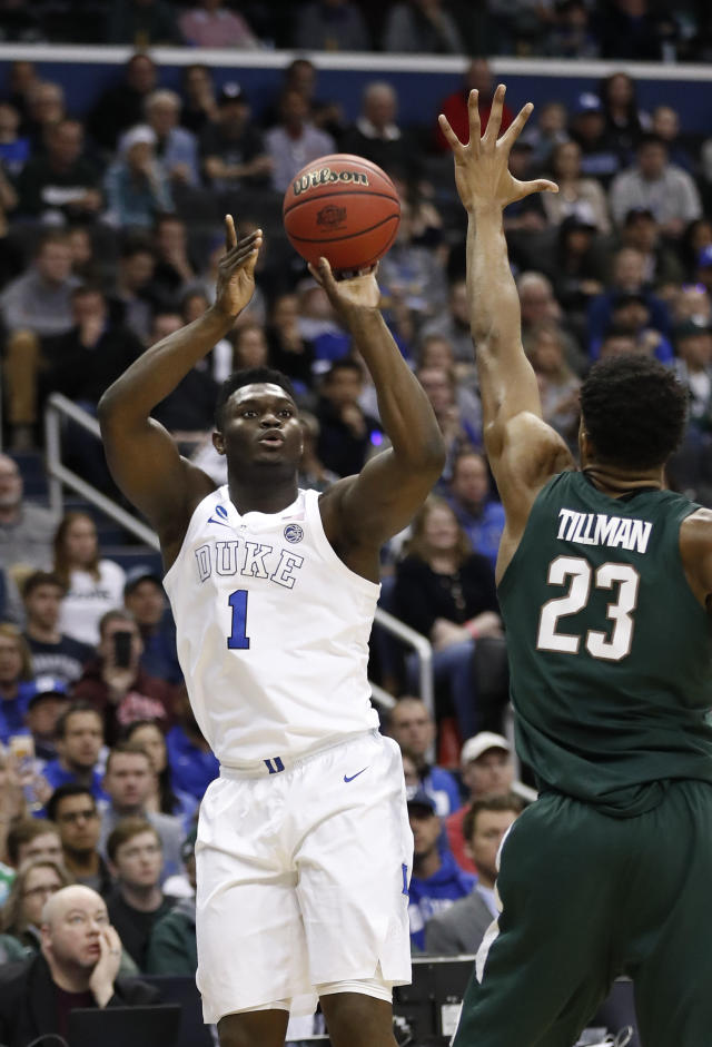 Duke forward Zion Williamson (1) shoots over Michigan State forward Xavier Tillman (23) during the first half of an NCAA men's East Regional final college basketball game in Washington, Sunday, March 31, 2019. (AP Photo/Patrick Semansky)