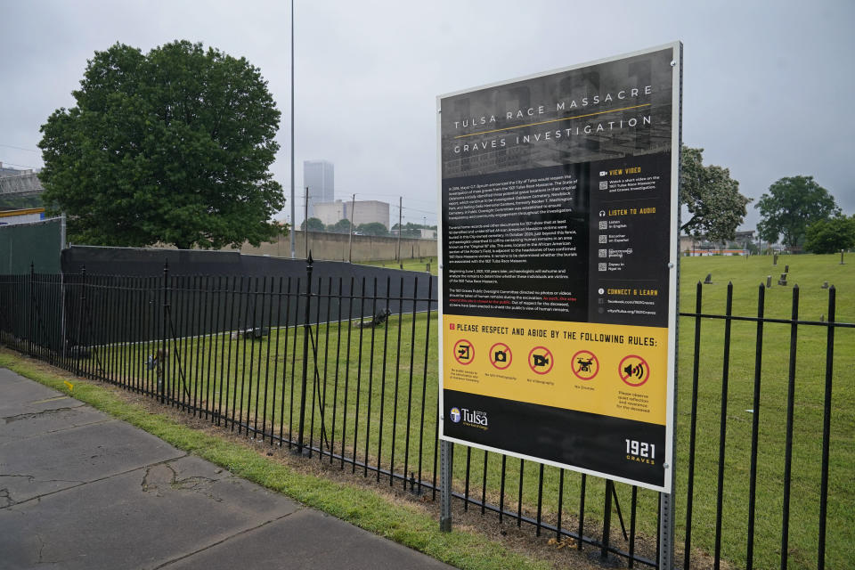A sign is pictured Oaklawn Cemetery in Tulsa, Okla., nearly 100 years after the Tulsa race massacre. Fencing has been erected and markers placed in the ground in preparation for the start of mapping, site preparation and excavations of Tulsa race massacre victims in mass graves beginning June 1, 2021. (AP Photo/Sue Ogrocki)