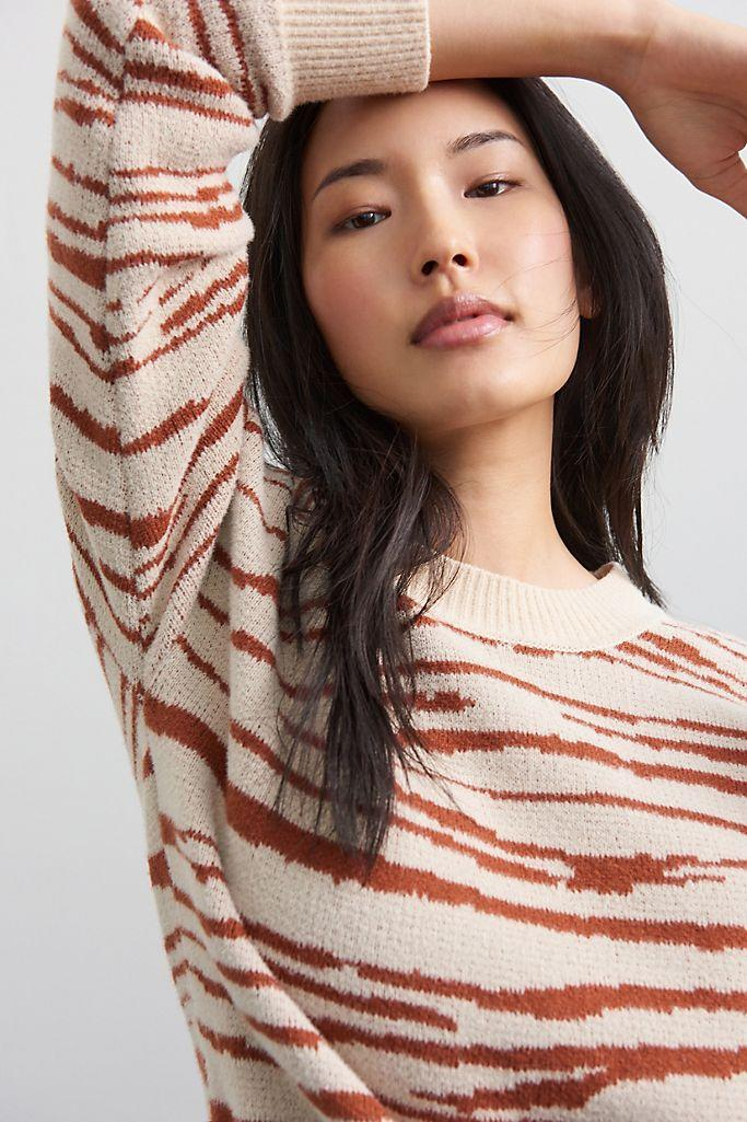 """<h2>Zebra-Striped Tunic Sweater</h2><br>Animal print is here to stay, and we're not mad — especially when it comes in the form of an intarsia-knit tunic that gives the pattern a modern, pixelated effect.<br><br><strong>En Elly</strong> Zebra-Striped Tunic Sweater, $, available at <a href=""""https://go.skimresources.com/?id=30283X879131&url=https%3A%2F%2Fwww.anthropologie.com%2Fshop%2Fzebra-striped-tunic-sweater%3Fcategory%3Dtops-sweaters%26color%3D015%26type%3DSTANDARD%26quantity%3D1"""" rel=""""nofollow noopener"""" target=""""_blank"""" data-ylk=""""slk:Anthropologie"""" class=""""link rapid-noclick-resp"""">Anthropologie</a>"""