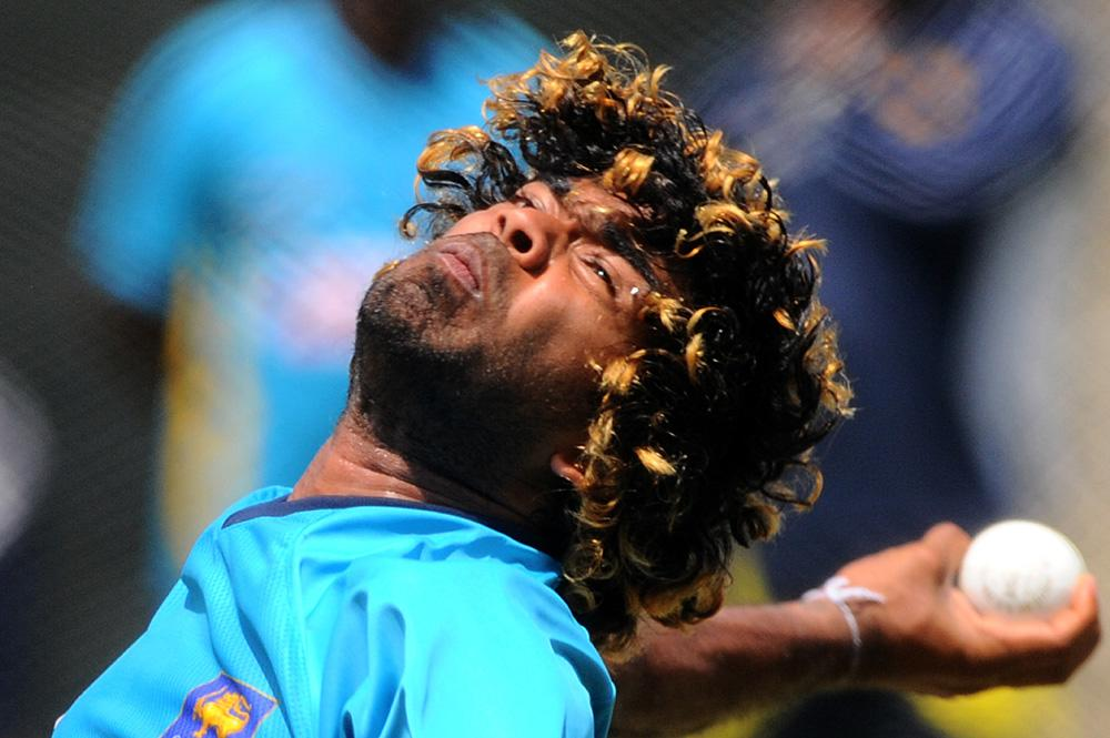 Sri Lankan cricketer Lasith Malinga delivers a ball during a practice session in Colombo on July 19, 2013.