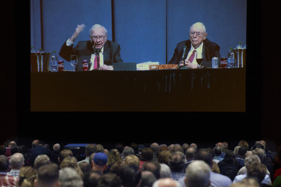 Shareholders in an overflow room watch on a big screen as Berkshire Hathaway Chairman and CEO Warren Buffett, left, and Vice Chairman Charlie Munger preside over the annual Berkshire Hathaway shareholders meeting in Omaha, Neb., Saturday, May 4, 2019. An estimated 40,000 people are thought to be in town for the event, where Buffett and Munger spend hours answering questions. (AP Photo/Nati Harnik)