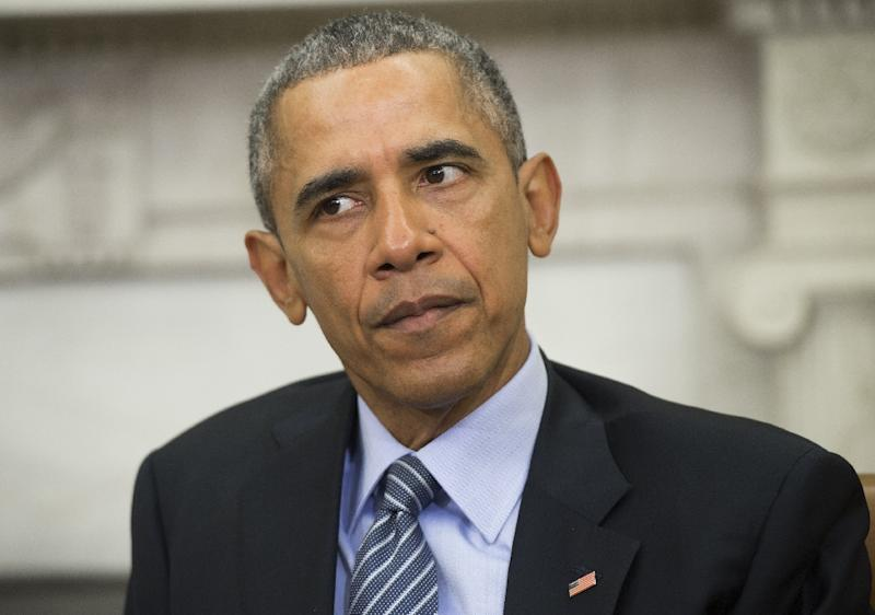 US President Barack Obama says that a US-led operation against the Islamic State group has been able to contain the jihadists' advance (AFP Photo/Saul Loeb)