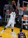 New Orleans Pelicans forward Zion Williamson (1) dunks during the first quarter of the team's NBA basketball game against the Los Angeles Lakers Friday, Jan. 15, 2021, in Los Angeles. (AP Photo/Ashley Landis)