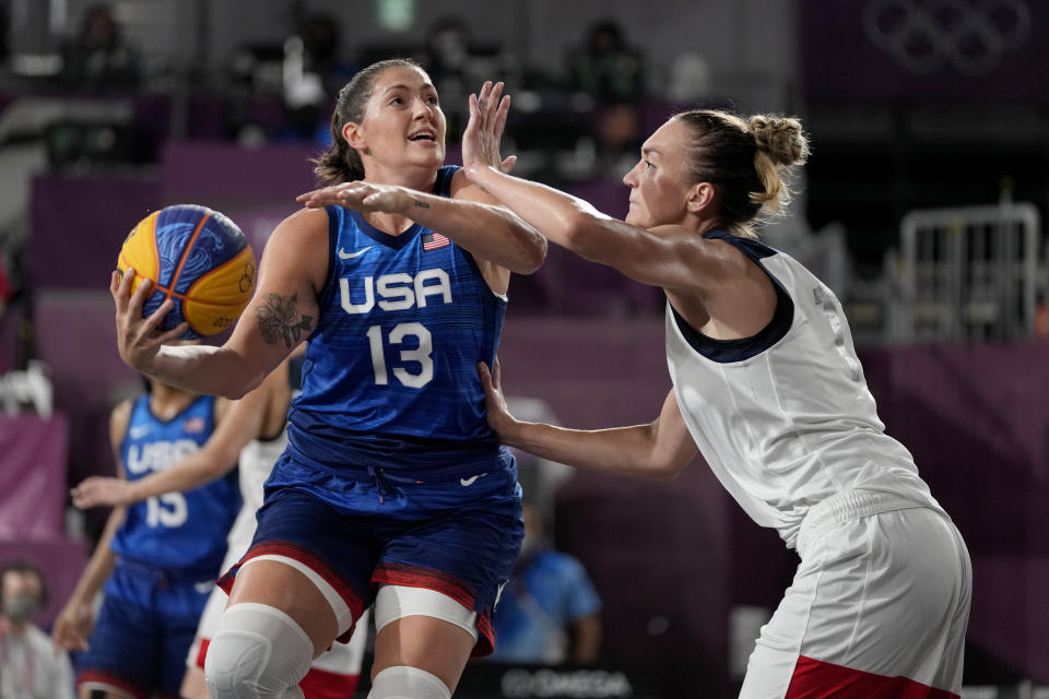 United States' Stefanie Dolson (13) heads to the basket past Anastasiia Logunova, of the Russian Olympic Committee, during a women's 3-on-3 basketball game at the 2020 Summer Olympics, Sunday, July 25, 2021, in Tokyo, Japan. (AP Photo/Jeff Roberson)