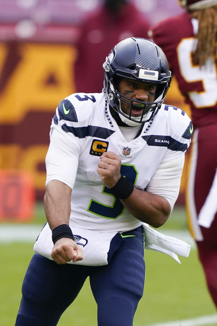 Seattle Seahawks quarterback Russell Wilson (3) celebrating his touchdown pass to tight end Jacob Hollister (86) during the first half of an NFL football game against the Washington Football Team, Sunday, Dec. 20, 2020, in Landover, Md. (AP Photo/Susan Walsh)