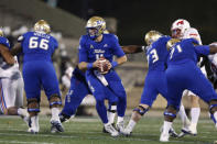 Tulsa quarterback Zach Smith (11) looks for a receiver during the second half of the team's NCAA college football game against SMU in Tulsa, Okla., Saturday, Nov. 14, 2020. (AP Photo/Joey Johnson)