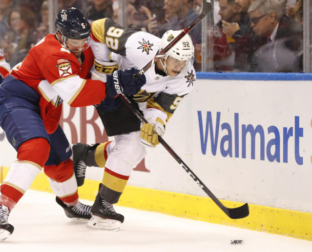 Florida Panthers defenseman Aaron Ekblad (5) and Vegas Golden Knights left wing Tomas Nosek (92) battle for the puck during the first period of an NHL hockey game, Saturday, Feb. 2, 2019, in Sunrise, Fla. (AP Photo/Wilfredo Lee)