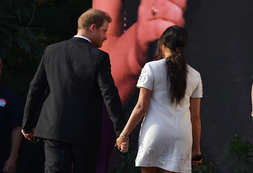 Prince Harry and Meghan Markle leave hand in hand after speaking during Global Citizen Live in Central Park on Sept. 25, 2021, in New York.