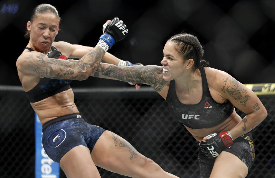 Amanda Nunes, right, hitting Germaine de Randamie in a mixed martial arts women's bantamweight championship bout at UFC 245, in Las Vegas. Nunes, the pound-for-pound superstar is an overwhelming favorite in her featherweight title defense against Canadian contender Felicia Spencer in UFC 250 scheduled for Saturday, June 6, 2020. (AP Photo/John Locher, File)