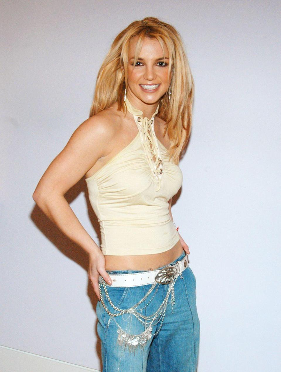 <p>Is it just me, or do you get all the nostalgic feels when you see halter tops? Also, chain belts like this were ~all the rage~ and only Britney Spears could convince me that I need one in this day and age.</p>