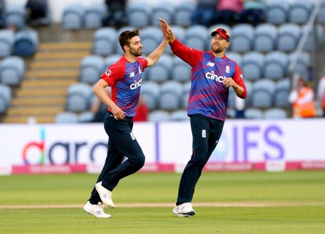 Mark Wood (left)  had two wickets in two balls