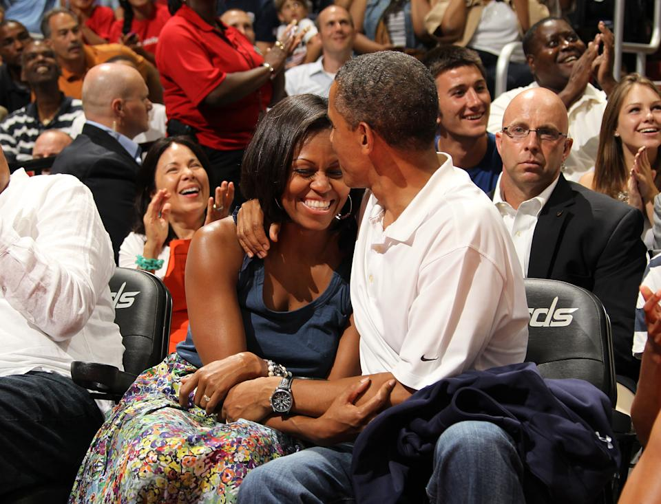 U.S. President Barack Obama and First Lady Michelle Obama on the Kiss Cam July 16, 2012. (Getty)