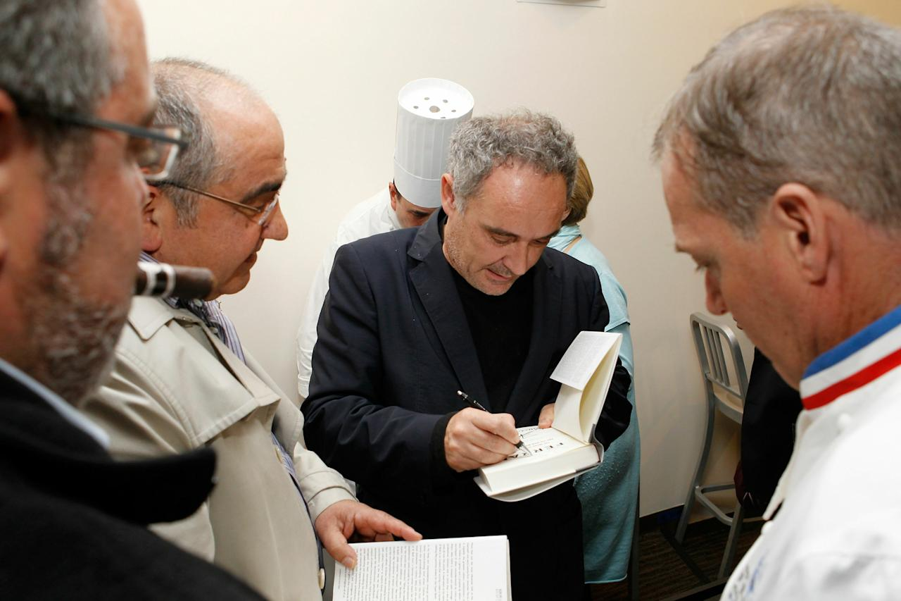 "NEW YORK - OCTOBER 12:  Chef Ferran Adria signs his new book ""Ferran: The Inside Story of El Bulli and the Man Who Reinvented Food"" at The International Culinary Center on October 12, 2010 in New York City.  (Photo by Mark Von Holden/Getty Images for The International Culinary Center)"