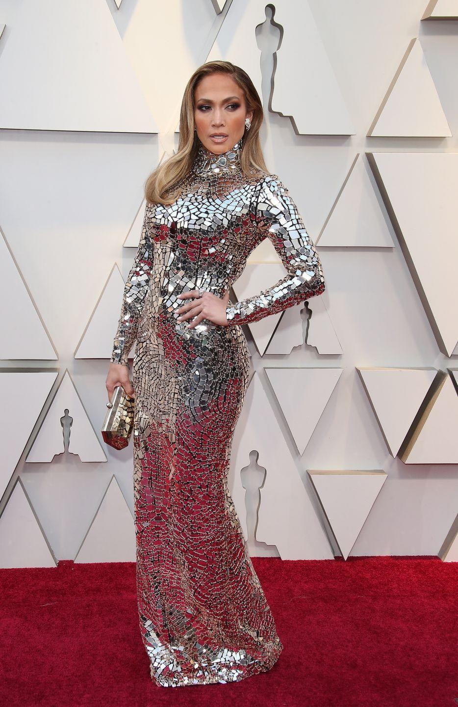 <p>Here J.Lo attends the 91st Academy Awards in a silver dress that has her looking like a shiny trophy herself. The hair, the pose, the face...teach me your ways J.Lo!</p>