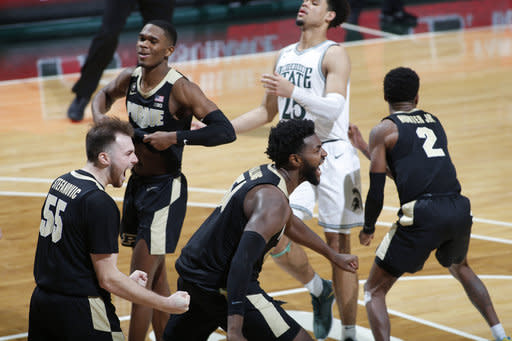Purdue's Trevion Williams, center, Sasha Stefanovic, left, Eric Hunter Jr., right, and Brandon Newman, left rear, celebrate following the team's NCAA college basketball game against Michigan State, Friday, Jan. 8, 2021, in East Lansing, Mich. Purdue won 55-54. (AP Photo/Al Goldis)