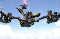 <p>George H. W. Bush celebrates his 80th birthday by parachuting with the United States Army Golden Knights in 2004. </p>