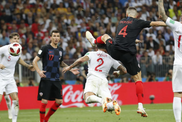Croatia's Ivan Perisic, right, scores his side's opening goal during the semifinal match between Croatia and England at the 2018 soccer World Cup in the Luzhniki Stadium in Moscow, Russia, Wednesday, July 11, 2018. (AP Photo/Frank Augstein)