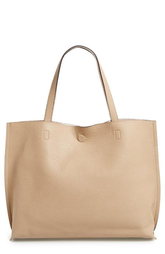 """<p>Street Level Reversible Faux Leather Tote & Wristlet, $48, <a href=""""http://shop.nordstrom.com/s/street-level-reversible-faux-leather-tote-wristlet/3559375?cm_mmc=Google_Product_Ads_pla_online-_-datafeed-_-juniors_women%3Abags%3Atote-_-935495&%3Bcountry=US&%3Bcurrency=USD&mr%3AreferralID=2261c01b-c399-11e5-ba16-005056946dac&gclid=CKzb747YxcoCFYIlHwodHE8BqQ"""" rel=""""nofollow noopener"""" target=""""_blank"""" data-ylk=""""slk:Nordstrom"""" class=""""link rapid-noclick-resp"""">Nordstrom</a>.<br></p>"""